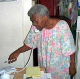 Fannie Lewis working the phones