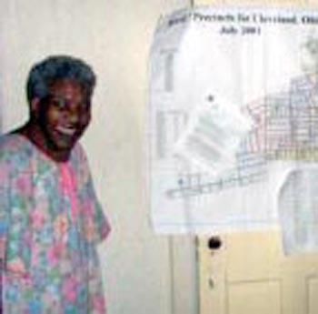Fannie Lewis with a map of her Ward
