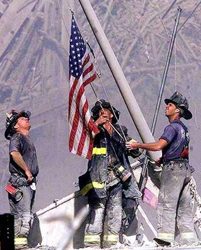 September 11,2001 fireman raising flag