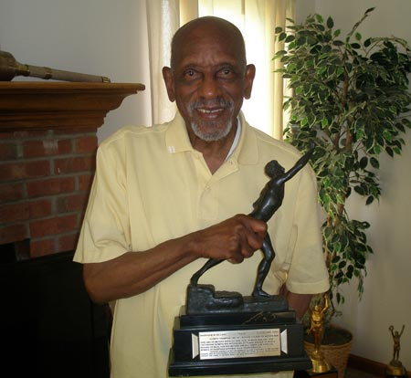 Olympic Gold Medal Champion Harrison Dillard with one of his many awards (photos by Debbie Hanson)