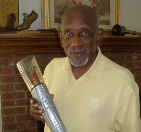 Harrison Dillard holding one of his Olympic torches (photos by Debbie Hanson)