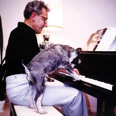 Howard Hoffmann duets with dog on piano