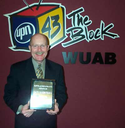 WUAB anchor Jack Marschall with is award
