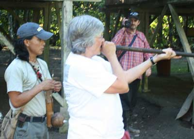 Cindy Cookinham using Blow Gun in the Amazon in 2007