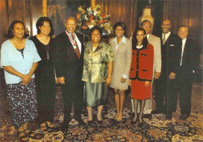 Louis Stokes receiving Congressional Distinguished Service Medal; from left, Shelley Hammond (daughter), Jay Stokes (wife), Alberta Johnson, The Honorable Lori Stokes (daughter), Roy Johnson, Chuck Stokes (son), and Brian Thompson