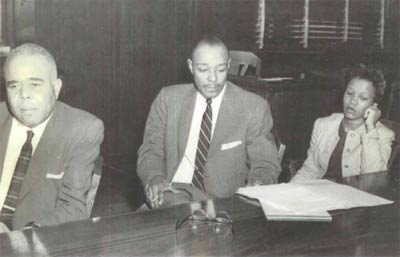Norman Minor, Louis Stokes and a defendant