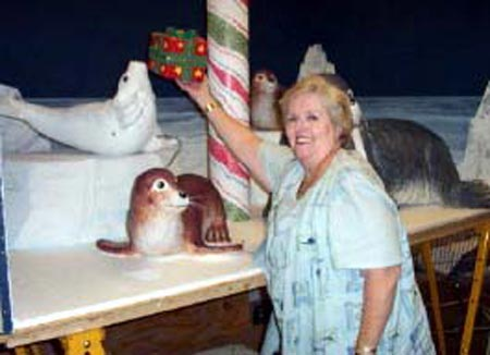 Adele Malley with Christmas display