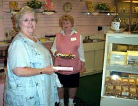 Adele Malley and worker at Malley's Chocolates