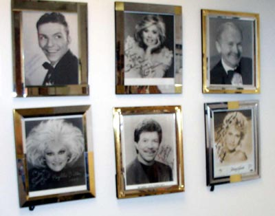 Photos of some of Marty Conn's friends like Frank Sinatra and Phyllis Diller