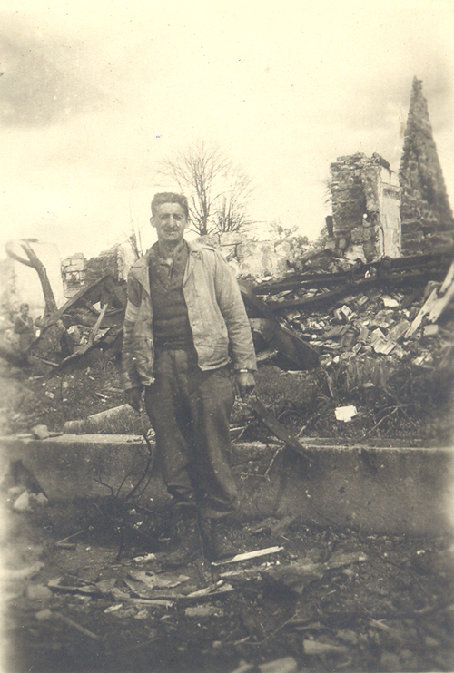 Maury Feren in the ruins of a town