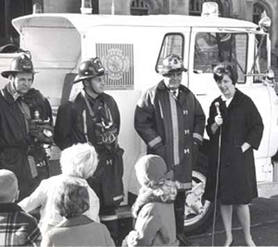 Fireman James Bud Sweeney with Romper Room's Miss Barbara Plummer