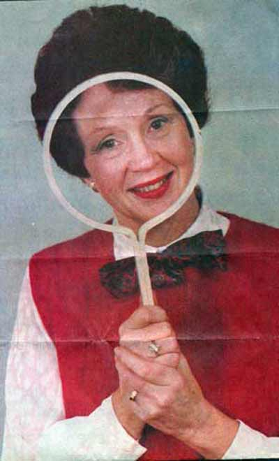 News Herald photo of Miss Barbara Plummer and Magic Mirror from 1988