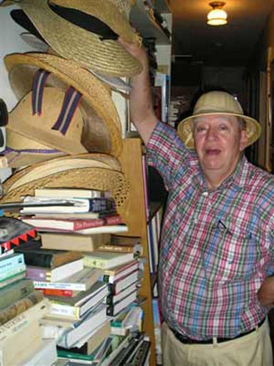 Richard Gildenmeister with some of his summer straw hats