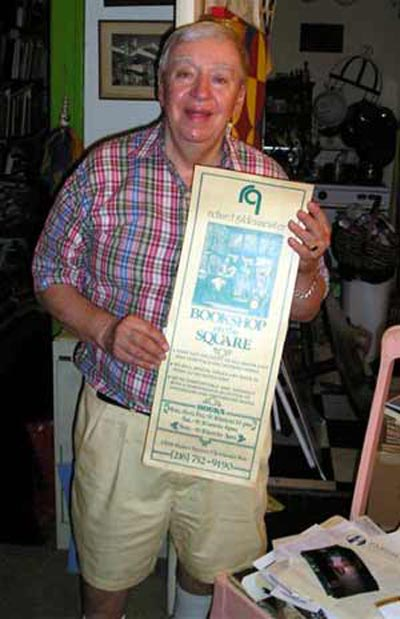 Richard Gildenmeister with sign from his store