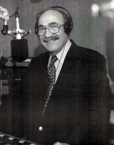 Ted Hallaman at the mic at WRMR in 2002