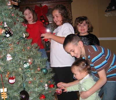 Tim Taylor's grandchildren trimming the tree Christmas 2007