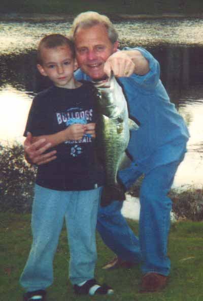 Tim Taylor and grandson fishing